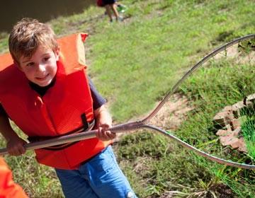 Boy fishing at Three Bears Acreas